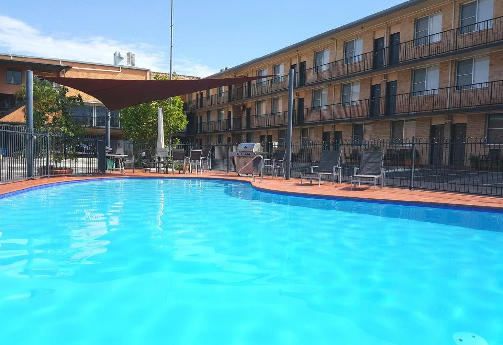 The swimming pool at or close to AZA Motel