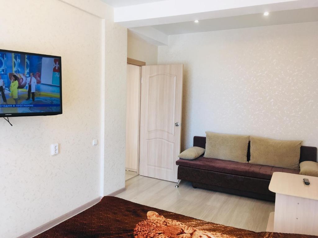 Телевизор и/или развлекательный центр в Apartment on Lenina 198