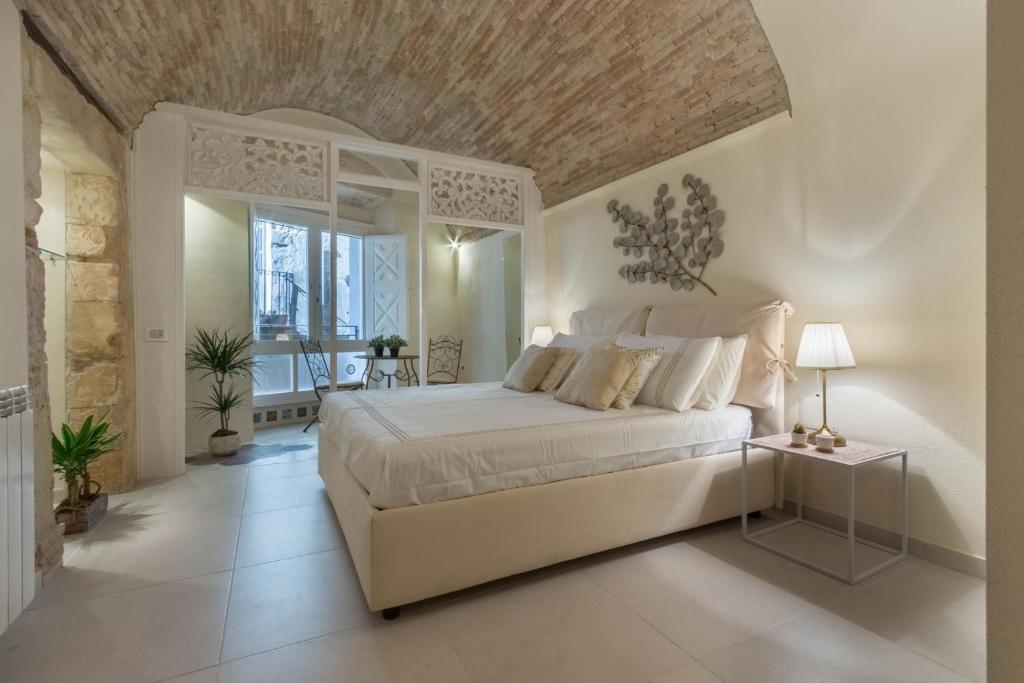 A bed or beds in a room at DOMO 5 TESTE