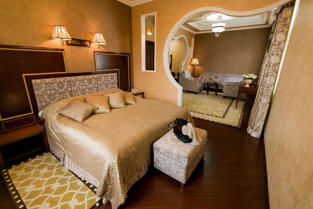 A bed or beds in a room at AllureInn Hotel and Spa