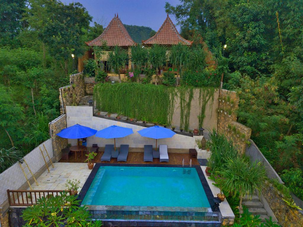 A view of the pool at Yoki's Bungalow or nearby
