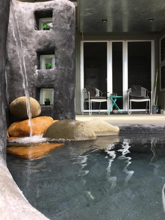 The swimming pool at or near Earthship Daintree