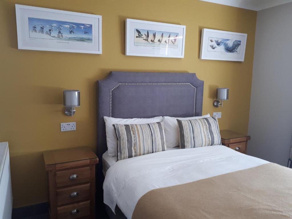 A bed or beds in a room at Muldowney's B&B