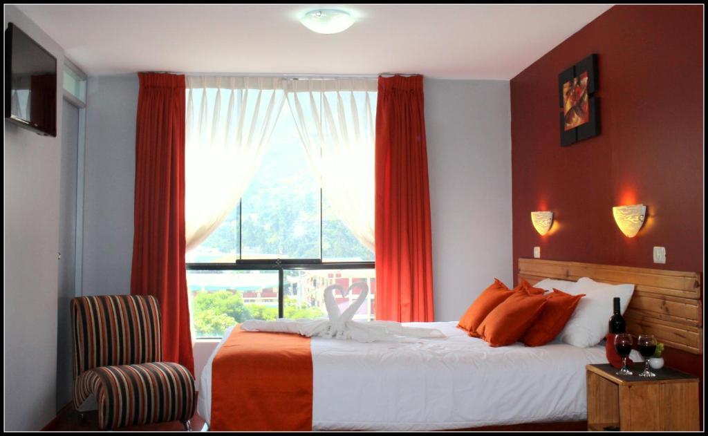 Cama o camas de una habitación en El Peregrino Apart Hotel