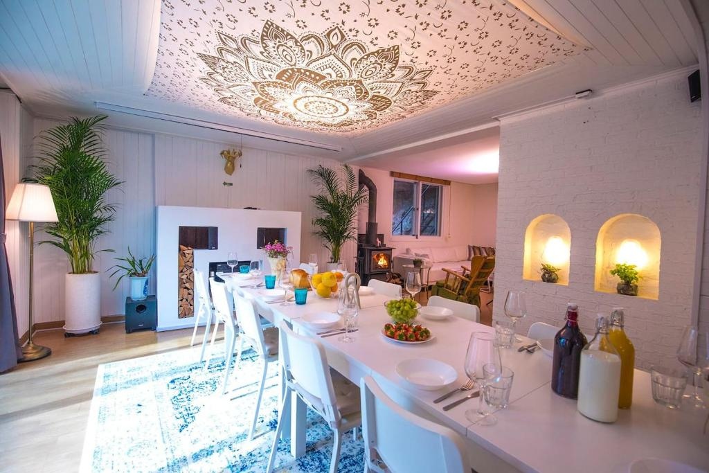 A restaurant or other place to eat at LUXURY HOLIDAYS INCLUDE VAN & CATERING & CONCIERGE
