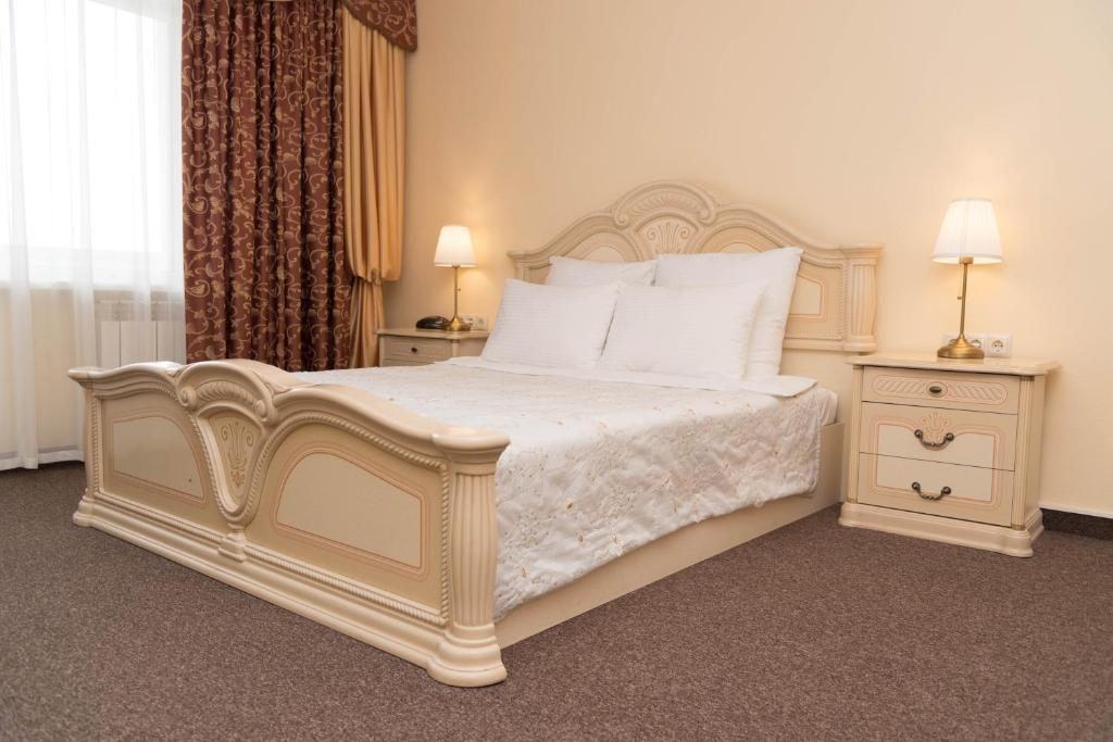 Кровать или кровати в номере Гостиница Гостиный Дом