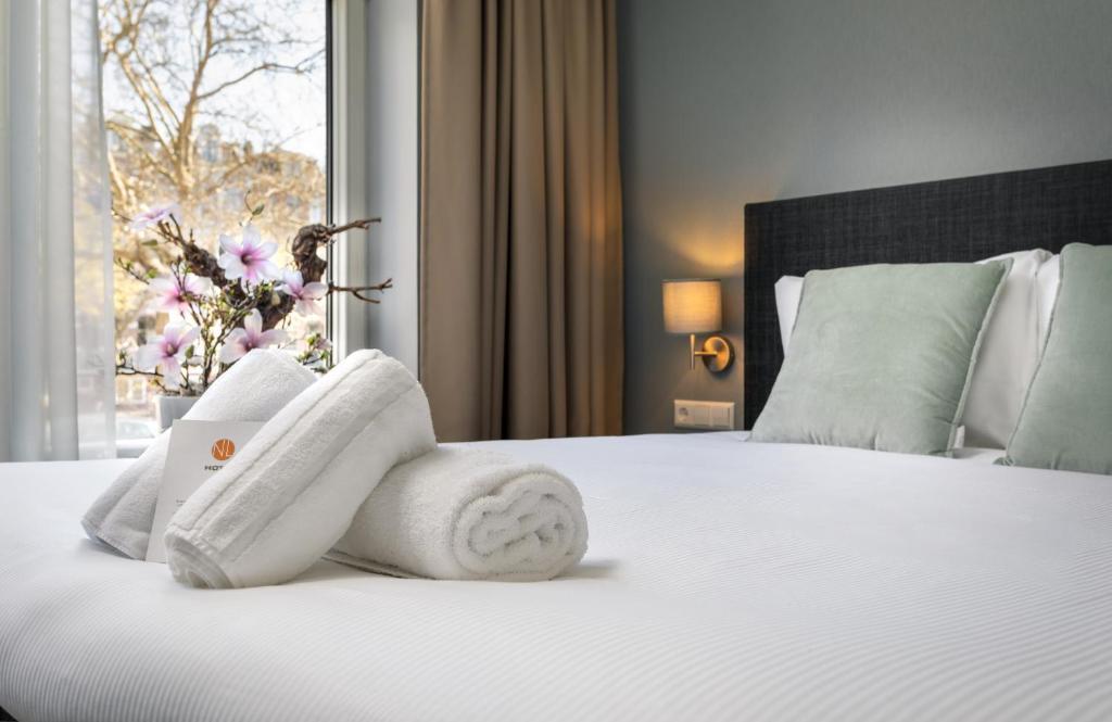 Кровать или кровати в номере NL Hotel District Leidseplein