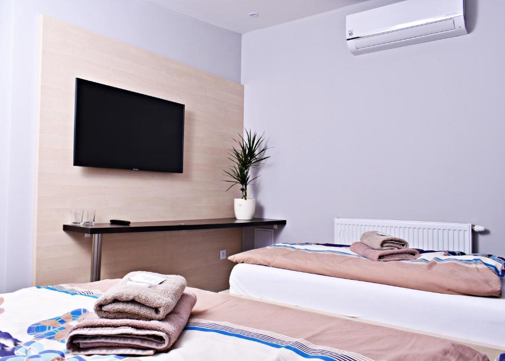 Posteľ alebo postele v izbe v ubytovaní Penzion Plaza