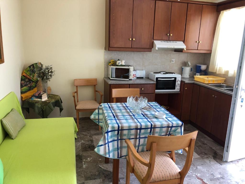 A kitchen or kitchenette at Holiday Dream Thalia Apartment