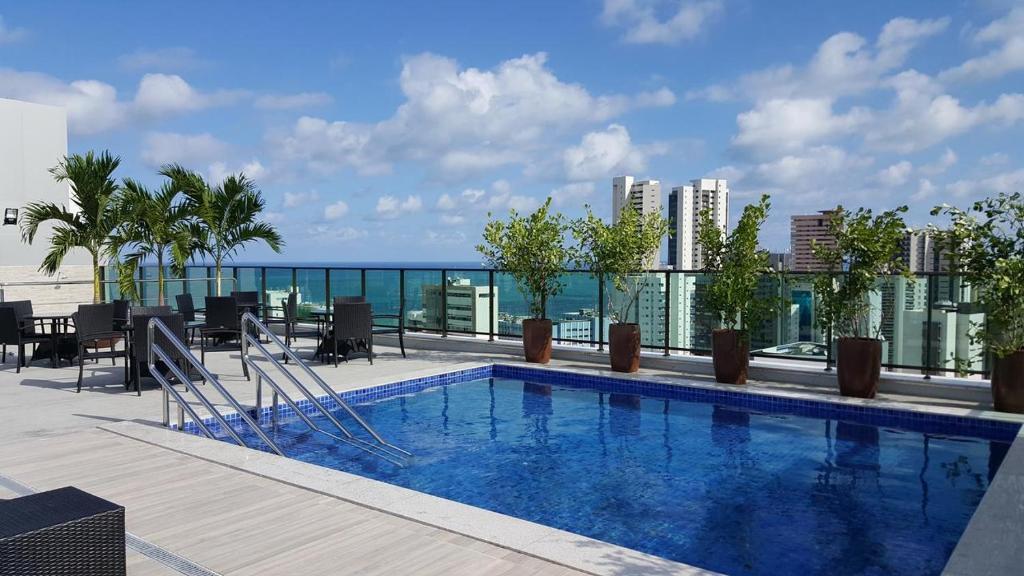 The swimming pool at or close to Flat Ramadam Beach
