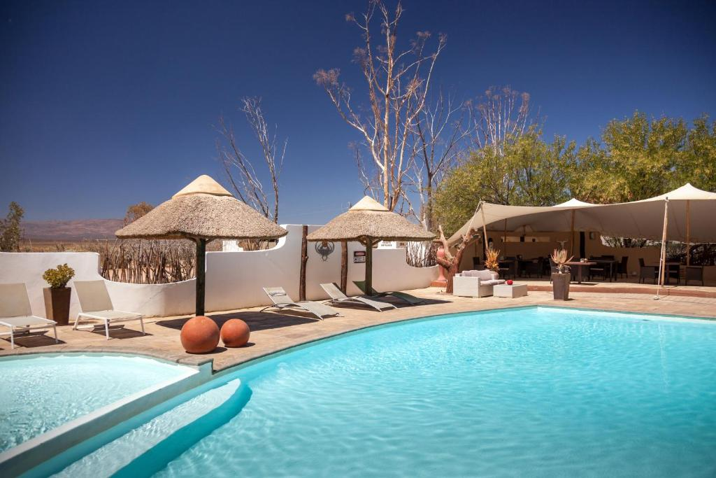 The swimming pool at or near Inverdoorn Game Reserve Lodge