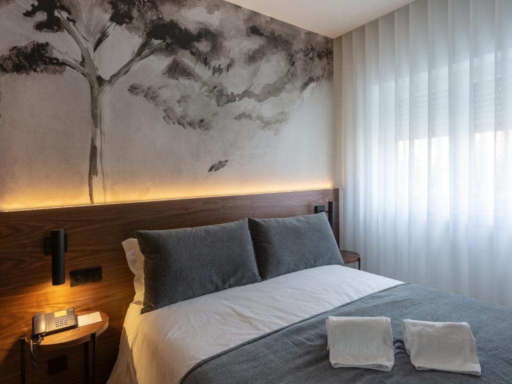 Uma cama ou camas num quarto em Hotel Afonso V