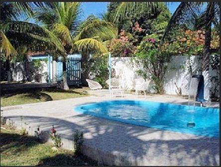 The swimming pool at or near Casa dos Sonhos - Carne de Vaca