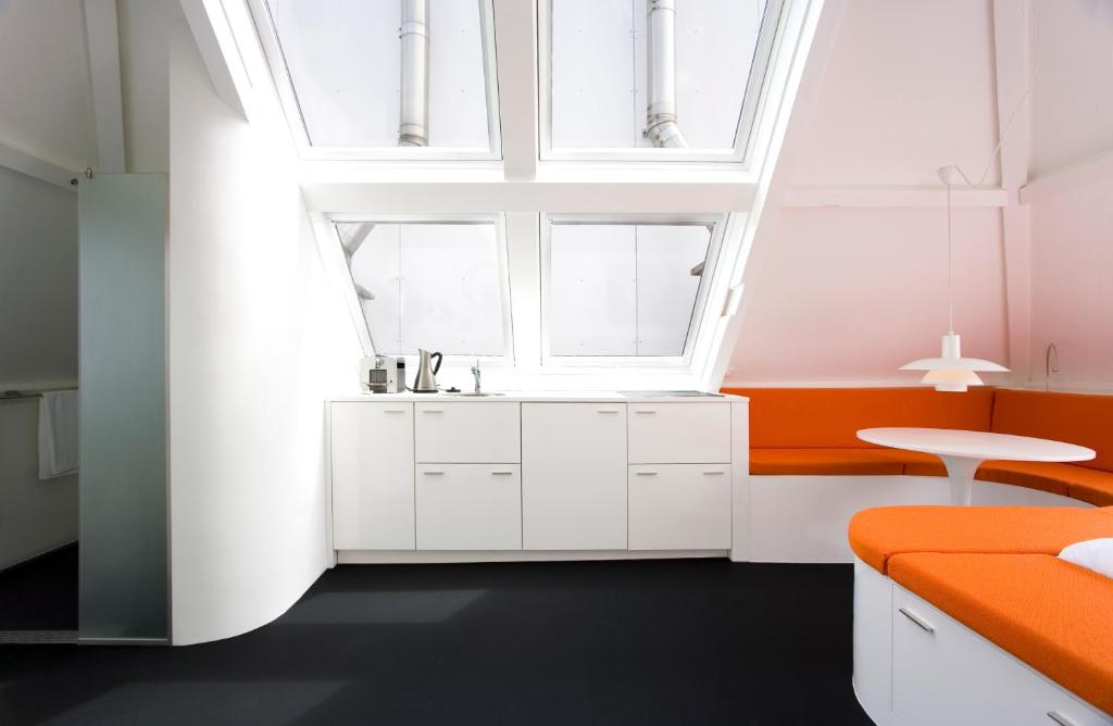 A kitchen or kitchenette at MAFF Top Apartment