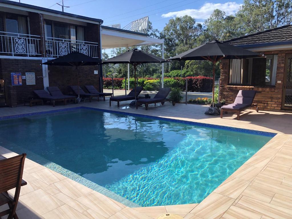 The swimming pool at or near Logan City Motor Inn