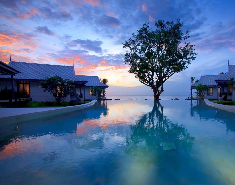 The swimming pool at or near Devasom Hua Hin Resort
