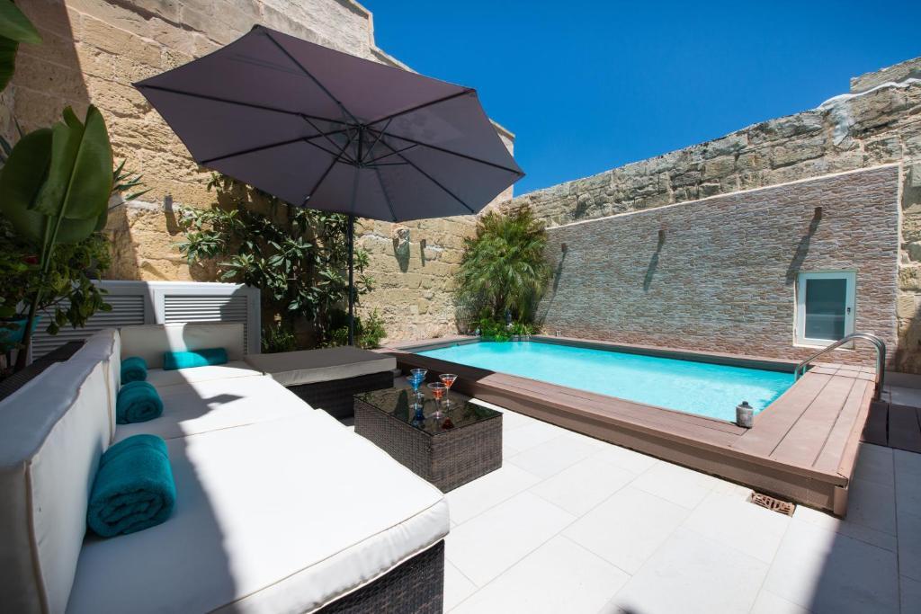 The swimming pool at or near Villa Naspla