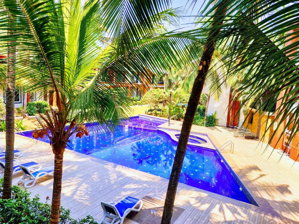 The swimming pool at or close to Goa Chillout Apartment - 1BHK
