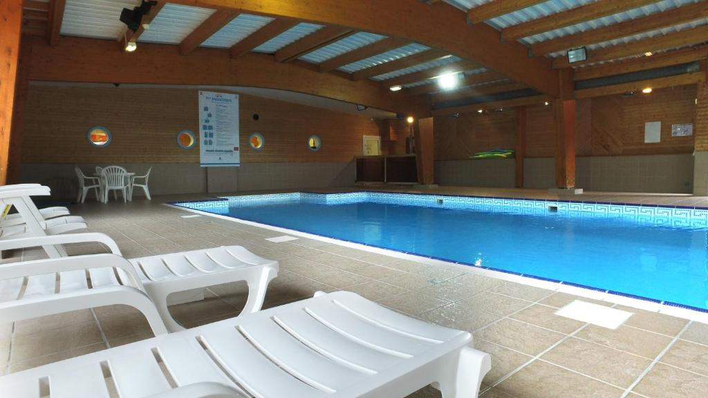 The swimming pool at or near VVF Villages « Les Monts du Cantal » Le Grand Lioran