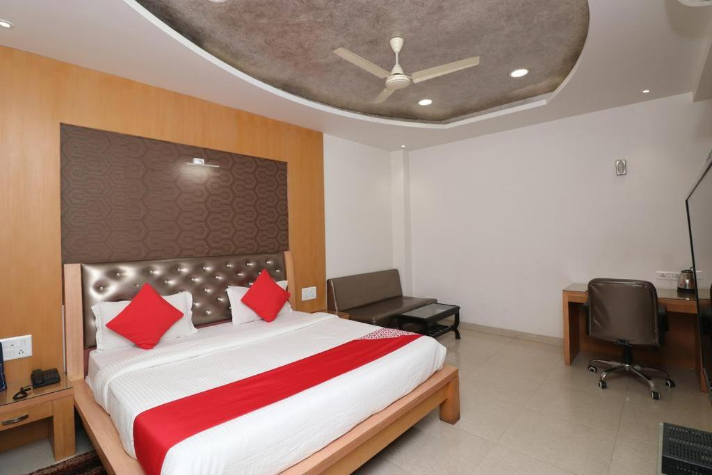 A bed or beds in a room at Bhagwati Palace