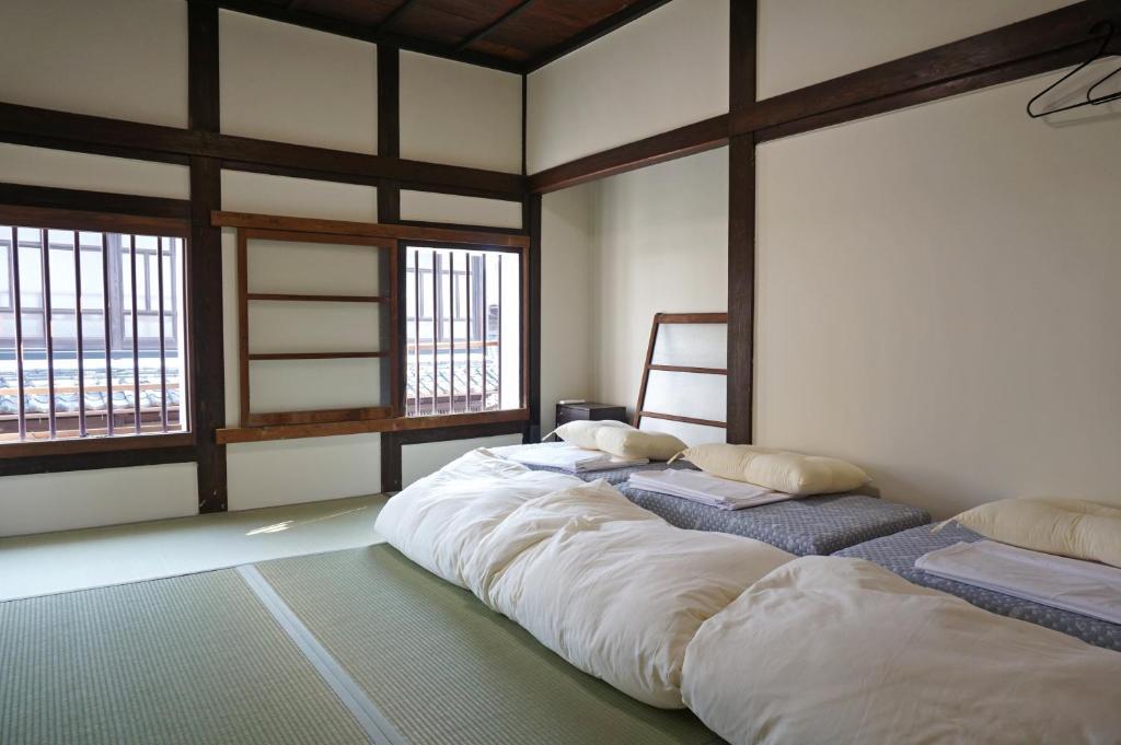 ゲストハウスあんどにあるベッド