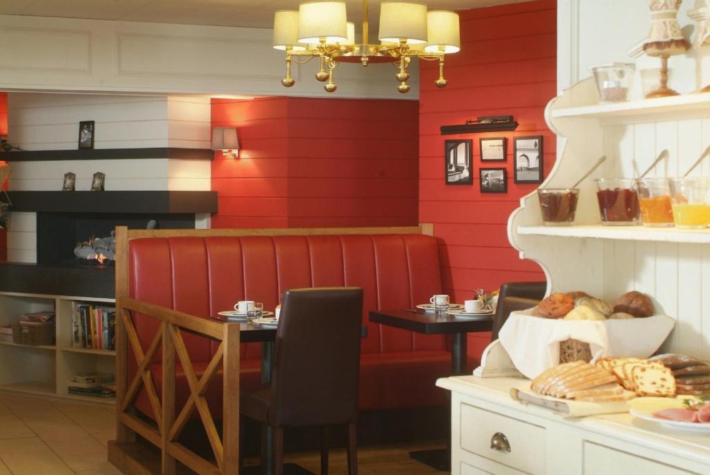 Een restaurant of ander eetgelegenheid bij Hotel Internos