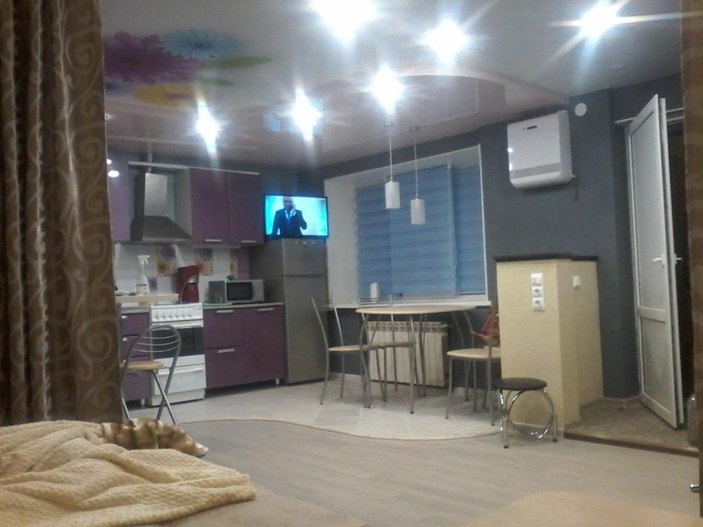 Телевизор и/или развлекательный центр в Apartment on Lenina 22
