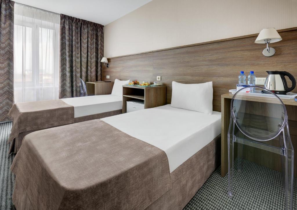 Кровать или кровати в номере Гостиница Звездная