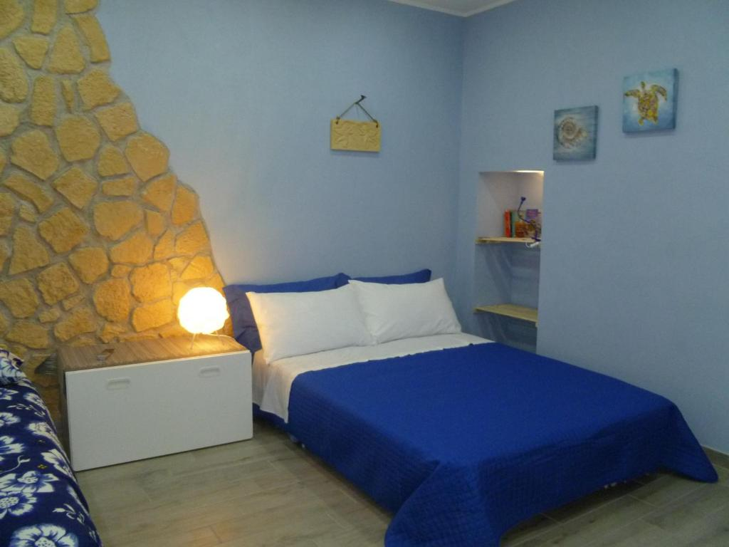 A bed or beds in a room at Casa Alessio