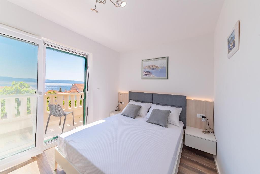 Postel nebo postele na pokoji v ubytování Casa ol'Bol - Modern New Apartment with Seaview and Terrace!