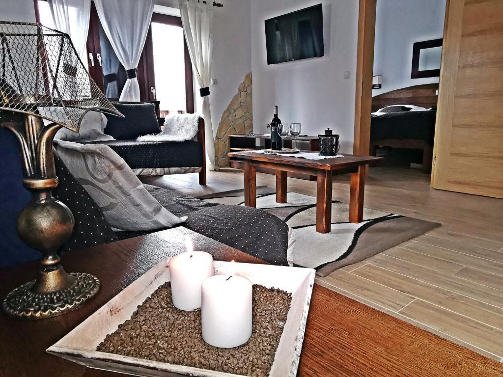 Posezení v ubytování Etno Garden Apartments