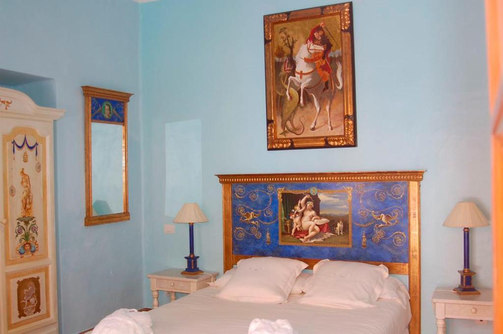 A bed or beds in a room at La Casona de Yaiza