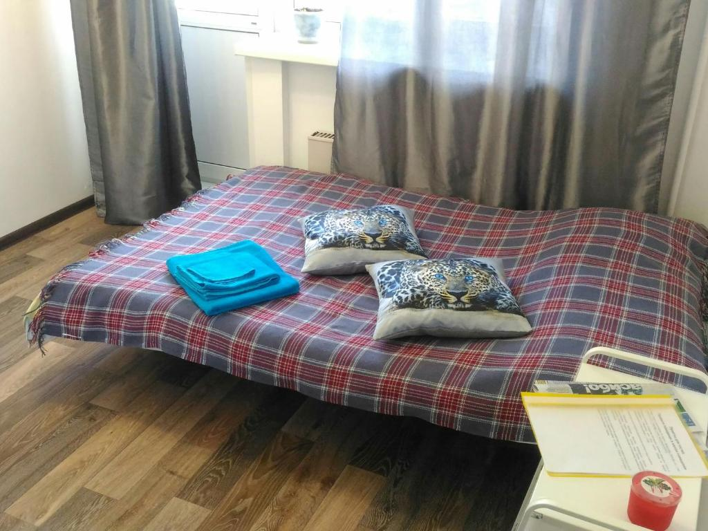 A bed or beds in a room at Cosy Apartment in Kryukovo