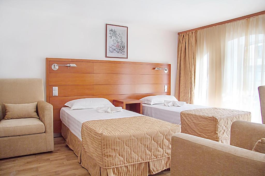 Кровать или кровати в номере Отель Ареал-ин