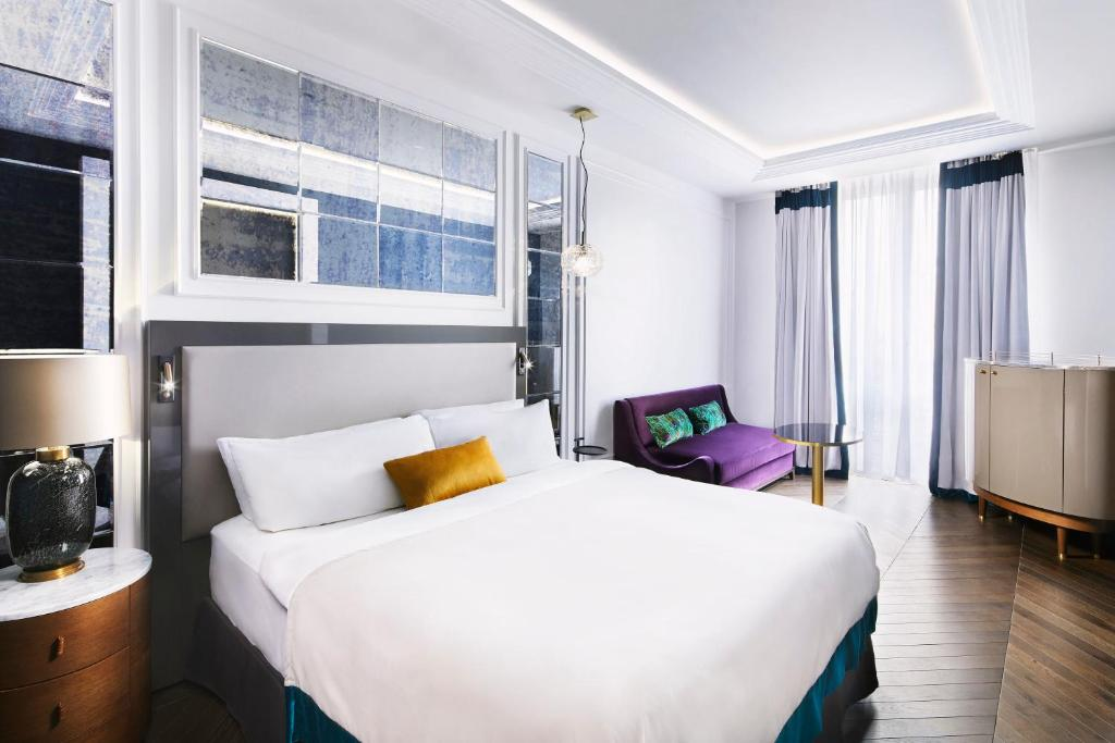 A bed or beds in a room at Sofia Hotel Balkan, a Luxury Collection Hotel, Sofia