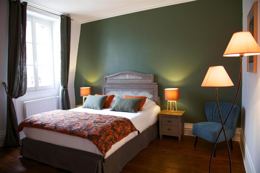 מיטה או מיטות בחדר ב-La bohème - Chambres d'hôtes