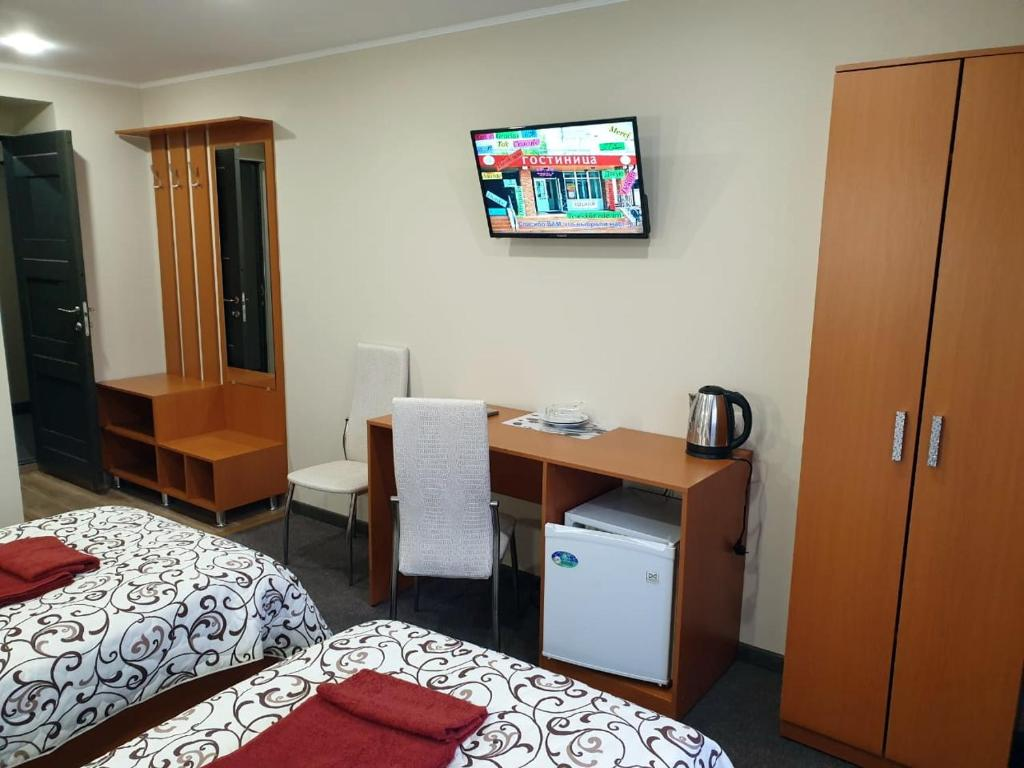 A television and/or entertainment center at Zul Hotel