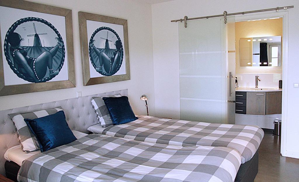 Кровать или кровати в номере Posthoorn Lodge