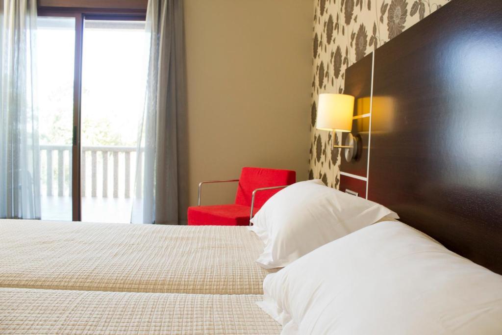 Cama o camas de una habitación en Hotel Piramide 2