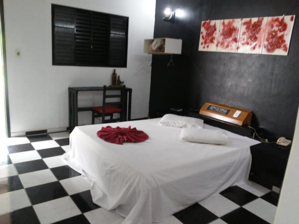 A bed or beds in a room at Hotel Patropi