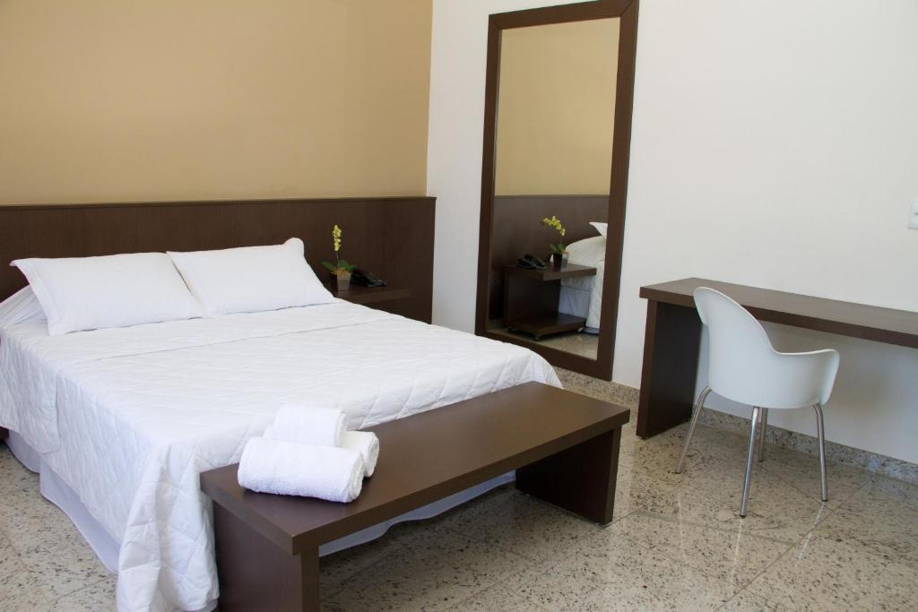 A bed or beds in a room at Santorini Hotel