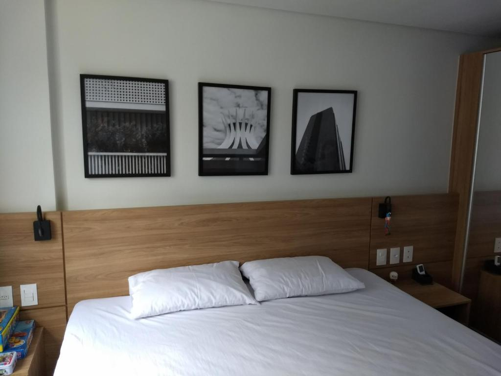 A bed or beds in a room at Granja Brasil