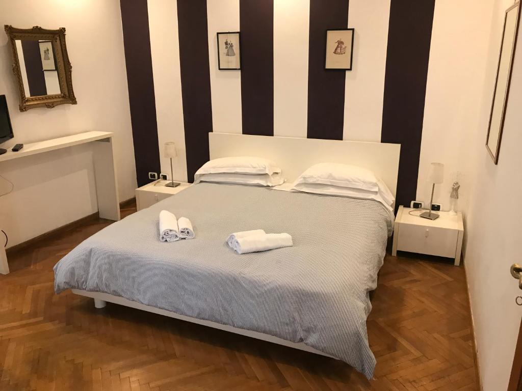 Un ou plusieurs lits dans un hébergement de l'établissement Piazza di Spagna Rome Apartments