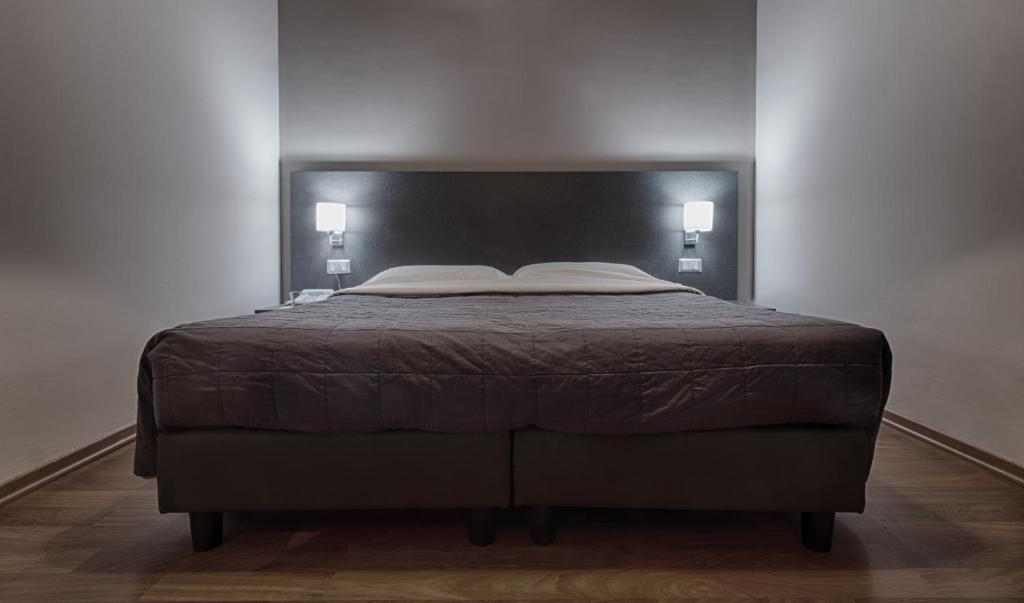 A bed or beds in a room at Twelve Hotel