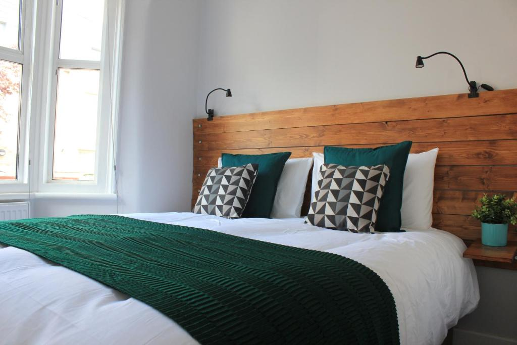 A bed or beds in a room at Alpha Place