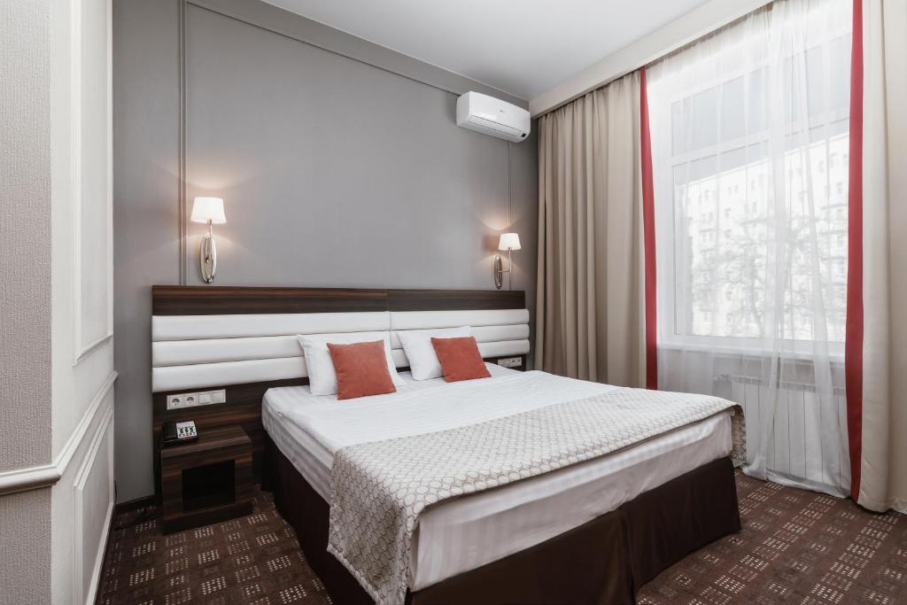 Кровать или кровати в номере Гостиница Сокол