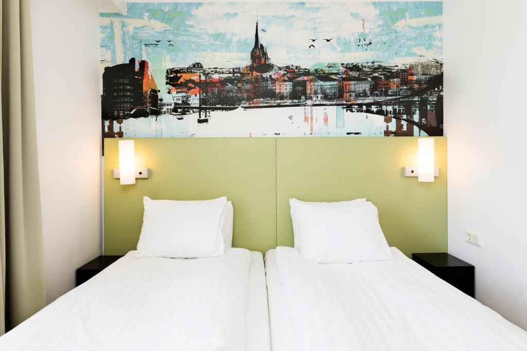 A bed or beds in a room at Good Morning Sundsvall