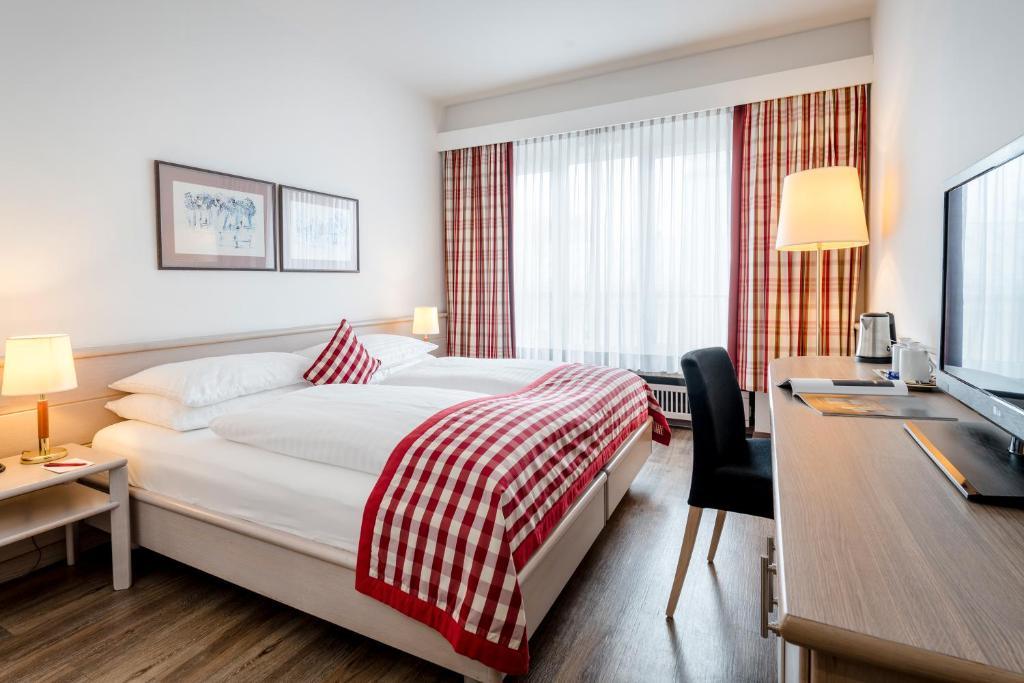 Ein Bett oder Betten in einem Zimmer der Unterkunft Hotel IMLAUER & Bräu