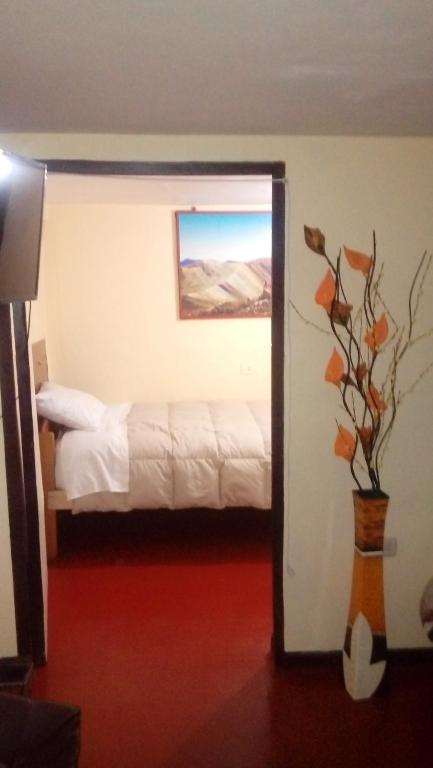 A bed or beds in a room at Apartment Sumaq Tika