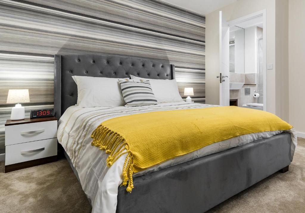 A bed or beds in a room at Fortified Luxury Apartment